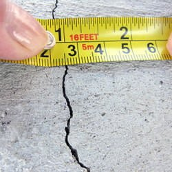 Tape measure showing width of crack