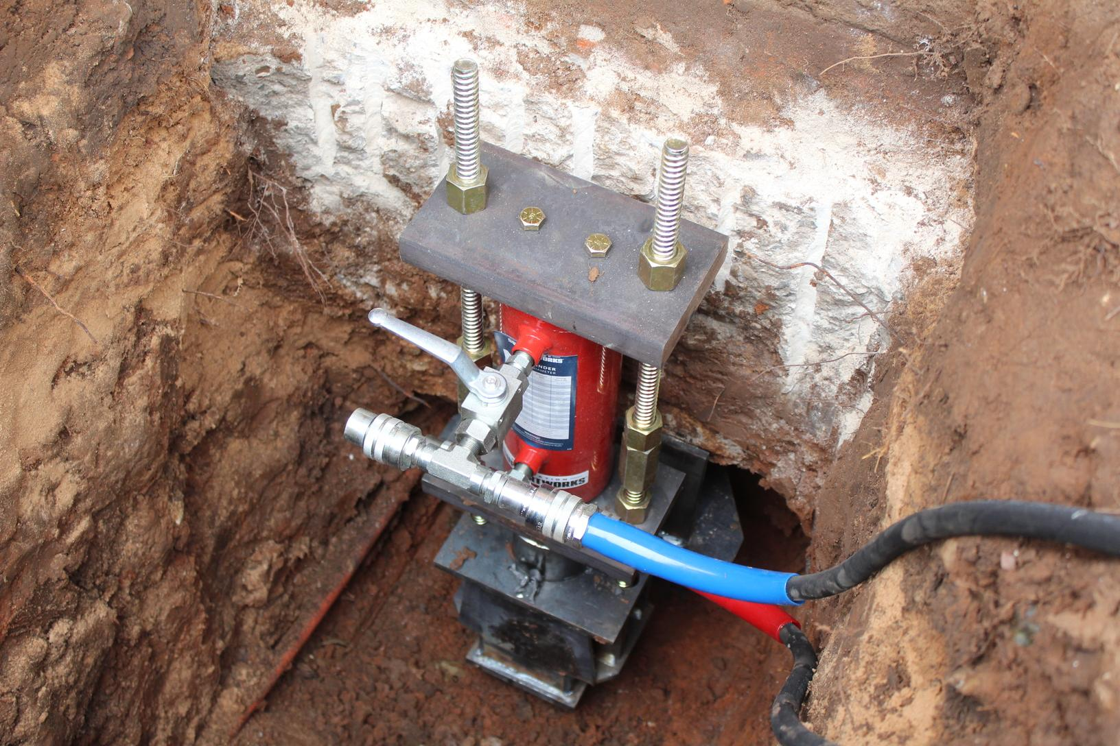 Vesta Foundation Solutions installed a hydraulic lift cylinder to help slowly lift the foundation back to its original position.
