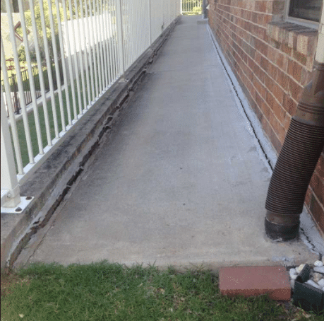 Ths sidewalk had settled along the entire length down the side of the house. This is a main entrance to the home and becoming a major trip hazard.