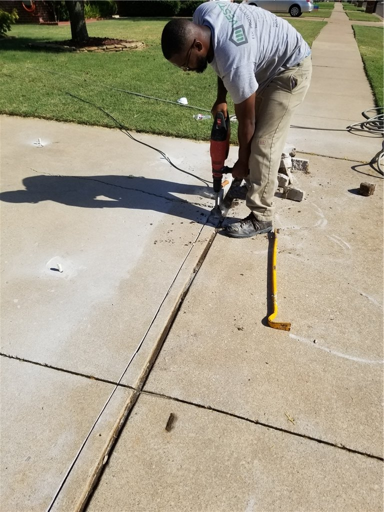 The concrete is cut using a diamond saw and lubricated with water to limit uneven cuts and dust.