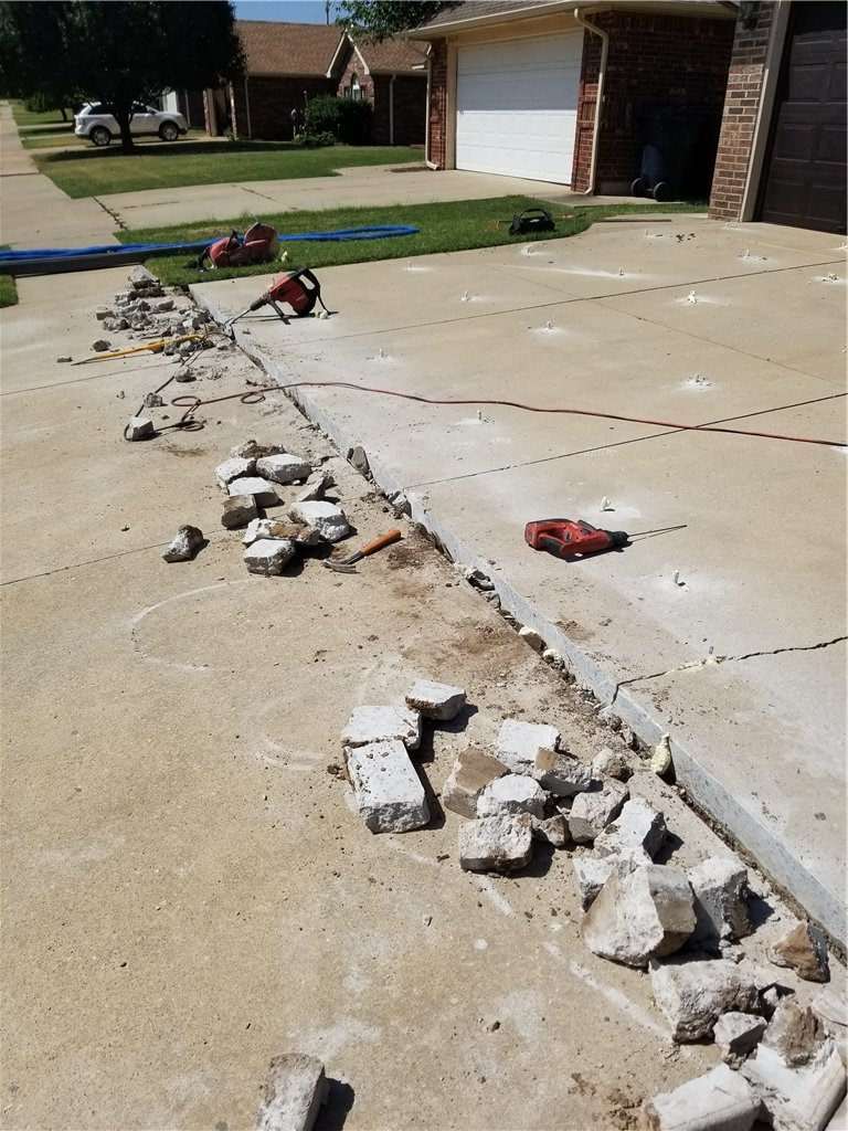 The debris and failed concrete expansion joint is completely removed. Then a bed of gravel is laid to give a stable surface for compression guard.