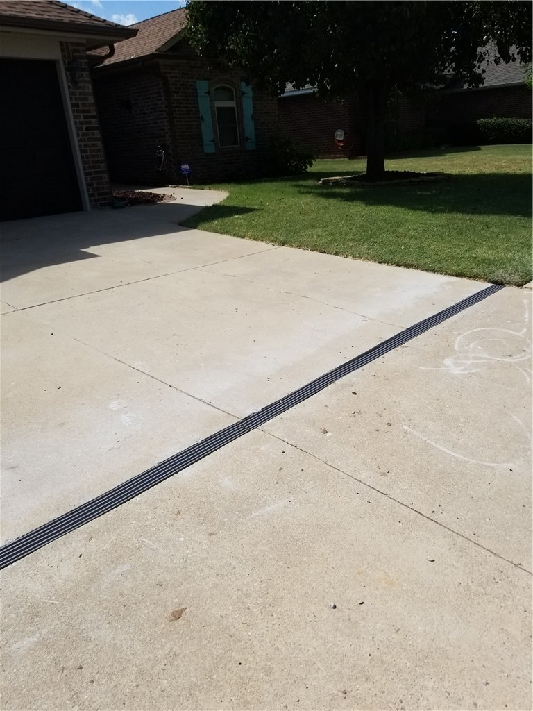 The compression guard is installed in a manner that matches the surface of the concrete. It can be pressure washed and cleaned very easily with your driveway.