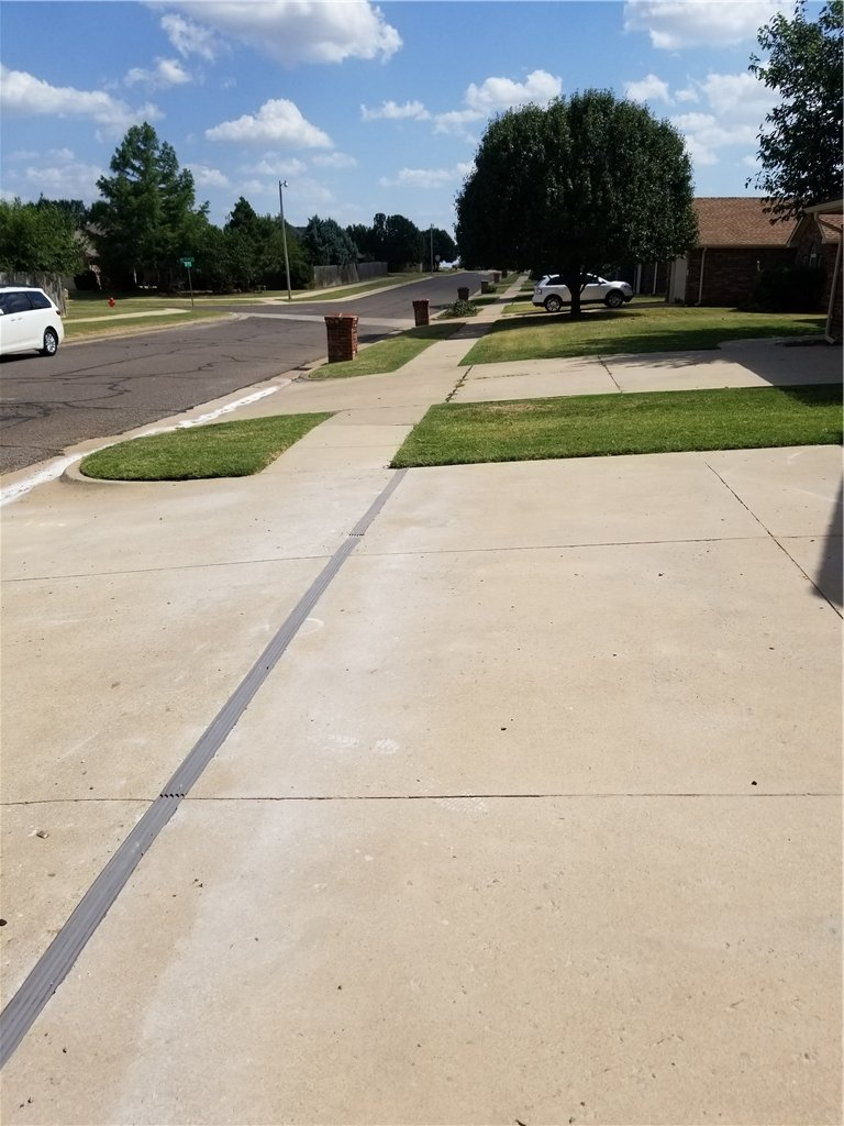 Once the job is complete, the driveway is swept clean of debris and the concrete is now permanently protected against movement from the street.