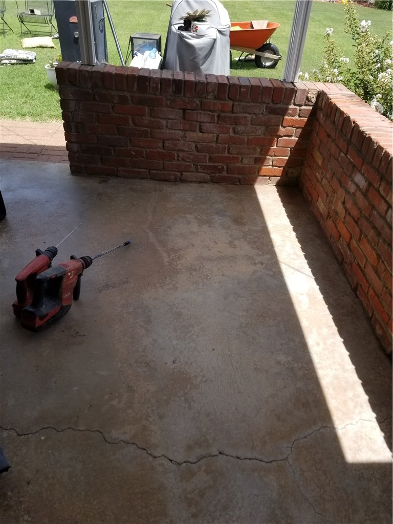 In many cases, the brick walls and surrounding structures can be lifted using the POLYlevel method rather than using piers for repair.