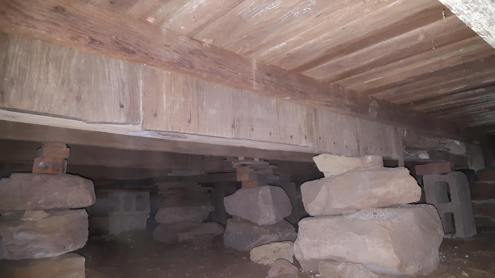 The original floor framing was supported with Stone and old concrete blocks. Because the foundations footing as never set properly the floor was very uneven upstairs.