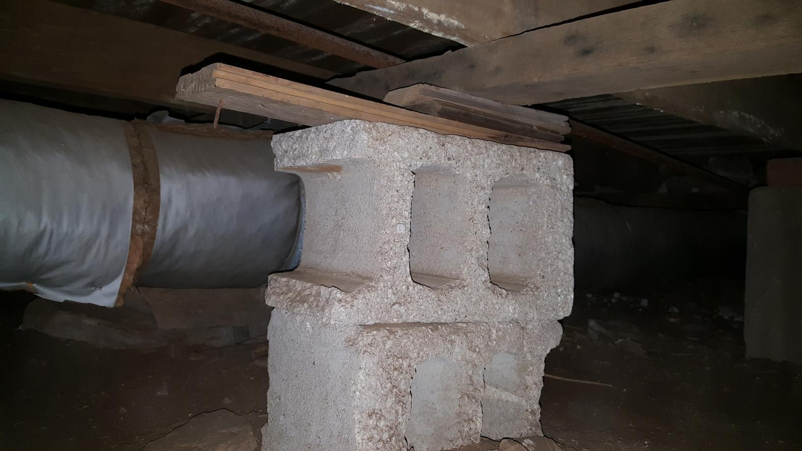 Many attempts in the past to shim or lift the floor framing was left with unstable concrete blocks not intended to fully support the home.