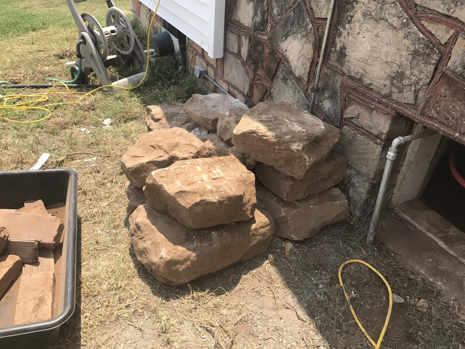 The debris is removed after and the leftover stones will become a future stone post by the homeowners!