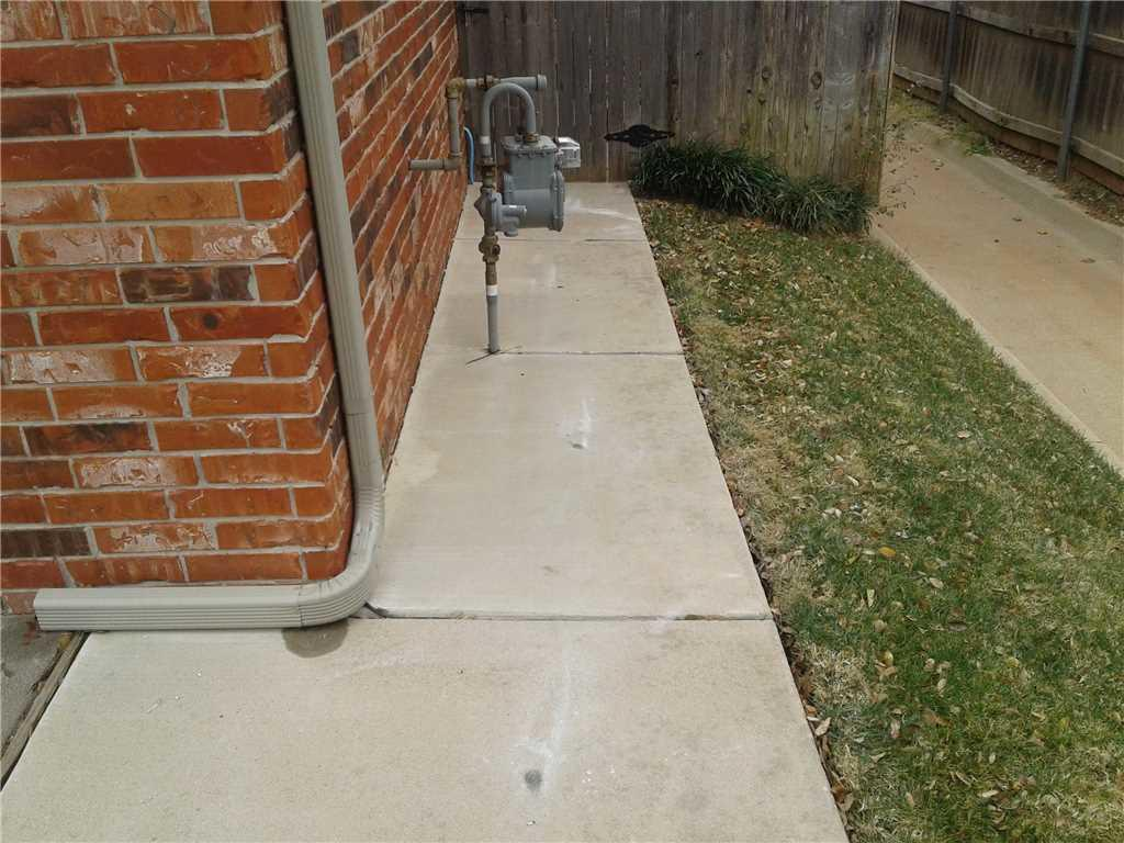 This repair to the sidewalk prevented damage to the Natural Gas meter.