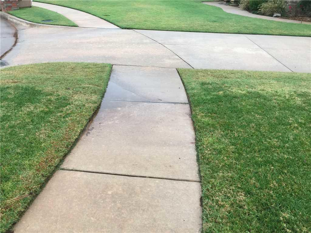 This sidewalk had 1 inch of water pooling during rains creating a nasty trip hazard for the homeowners and neighbors alike.