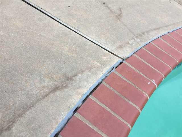 Finished Cement Joints and Pool Repair in Chickasha, OK - Before Photo