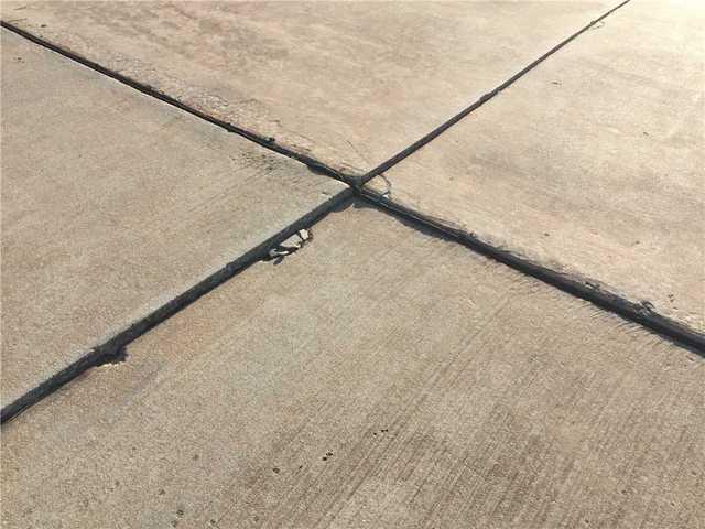 Tuttle, OK Driveway Repair - Before Photo