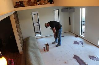 Setting Injection Ports in slab after carpet has been rolled back.