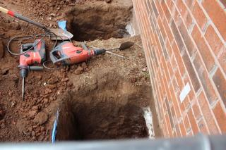 Holes excavated to install push piers.