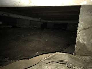 Exposed dirt crawl space