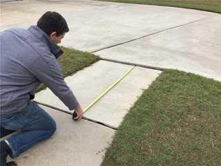Owner, Will Blake, showing how unlevel the sidewalk is