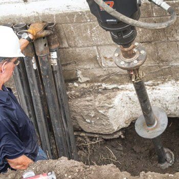 Vesta Foundation technician repairing foundation