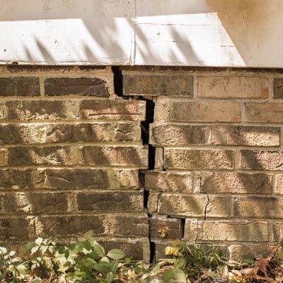 Cracked foundation brick wall