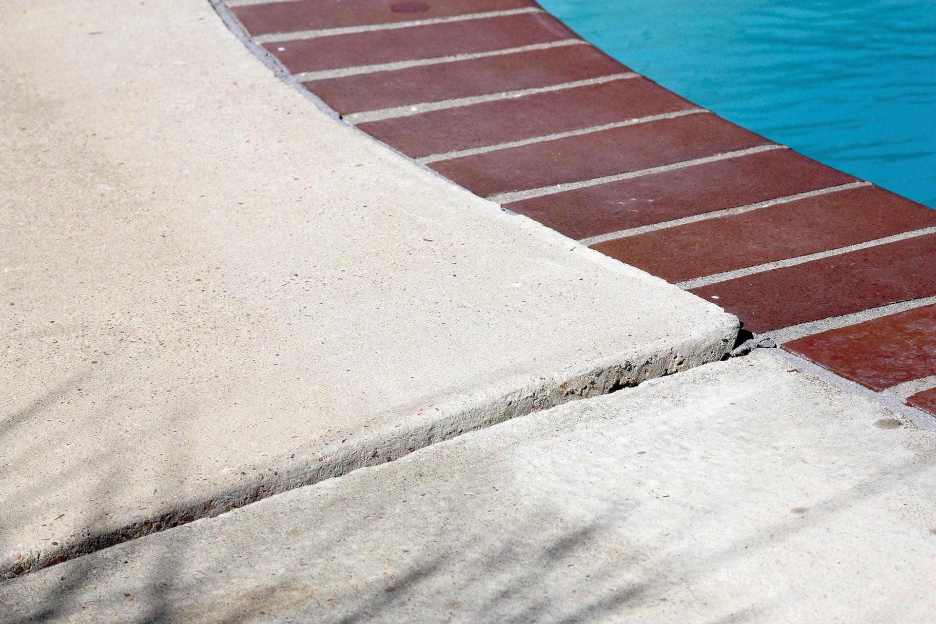 Example of uneven concrete on pool deck