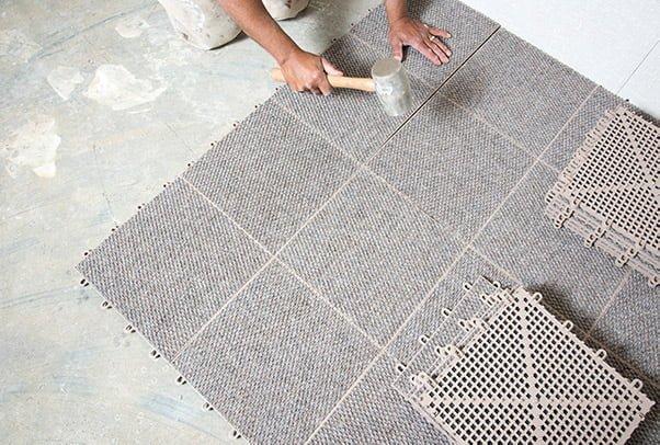 Vesta Foundation technician adding basement flooring protection